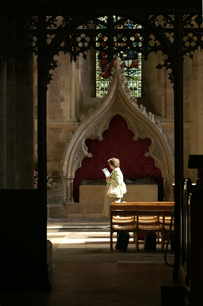 Contemplative moment in Romsey Abbey